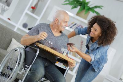 caregiver serving her senior patient