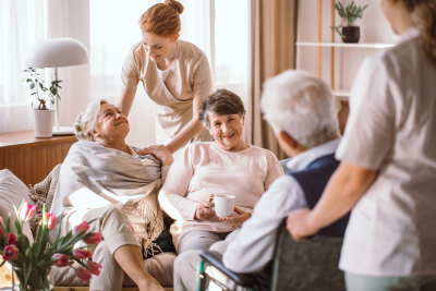 caregivers and seniors in a nursing home